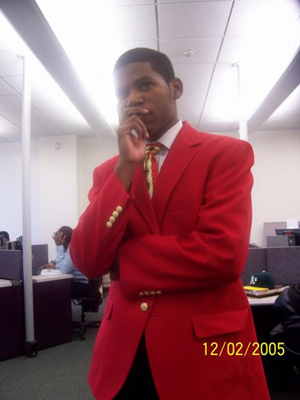 Trying to look deep in Hampton University's computer lab. Of course the photographer messes up my blazer with those numbers!! >:(
