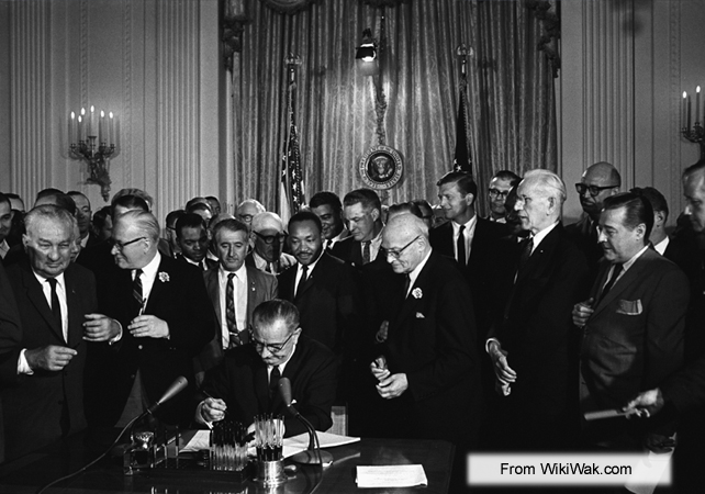 President Lyndon B. Johnson signing the Civil Rights Act of 1964 into law on July 2, 1964.